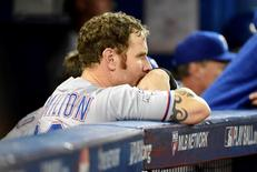 Texas Rangers left fielder Josh Hamilton reacts from the dugout against the Toronto Blue Jays in game five of the ALDS at Rogers Centre. Mandatory Credit: Peter Llewellyn-USA TODAY Sports