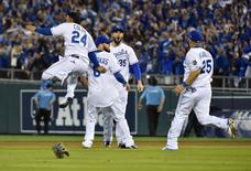 Oct 14, 2015; Kansas City, MO, USA; Kansas City Royals players including Christian Colon (24) , Mike Moustakas (8) , Eric Hosmer (35) and Kendrys Morales (25) celebrate on the field after defeating the Houston Astros in game five of the ALDS at Kauffman Stadium. Mandatory Credit: Peter G. Aiken-USA TODAY Sports