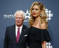 Former Canadian ambassador to Iran Ken Taylor and actress Elena Semikina arrive at the 2015 Canadian Screen Awards in Toronto, March 1, 2015. REUTERS/Mark Blinch