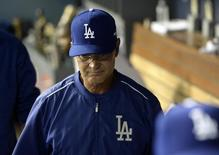 October 15, 2015; Los Angeles, CA, USA; Los Angeles Dodgers manager Don Mattingly (8) reacts following the 3-2 loss against New York Mets in game five of NLDS at Dodger Stadium. Mandatory Credit: Jayne-Kamin Oncea-USA TODAY Sports
