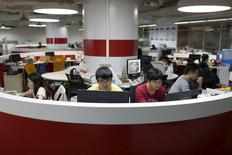 Young entrepreneurs work at an office area inside the University Students Venture Park, in Shanghai, China, July 29, 2015. REUTERS/Aly Song