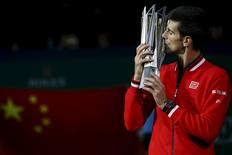 Novak Djokovic of Serbia kisses the trophy after winning the men's singles final match against Jo-Wilfried Tsonga of France at the Shanghai Masters tennis tournament in Shanghai, China, October 18, 2015.  REUTERS/Damir Sagolj