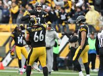 Pittsburgh Steelers quarterback Landry Jones (3) is lifted up by guard David DeCastro (66) after throwing an 88-yard touchdown pass against the Arizona Cardinals during the second half at Heinz Field. The Steelers won the game, 25-13. Mandatory Credit: Jason Bridge-USA TODAY Sports