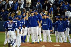 Oct 19, 2015; Toronto, Ontario, CAN; The Toronto Blue Jays celebrate after defeating the Kansas City Royals in game three of the ALCS at Rogers Centre. Toronto won 11-8.  Mandatory Credit: Dan Hamilton-USA TODAY Sports