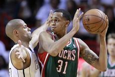 Milwaukee Bucks forward John Henson (R) looks to pass under pressure from Miami Heat forward Shane Battier during their NBA first round Game 1 playoff  basketball game in Miami, Florida April 21, 2013. REUTERS/Joe Skipper
