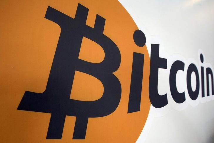 A Bitcoin logo is displayed at the Bitcoin Center New York City in New York's financial district July 28, 2015. REUTERS/Brendan McDermid/Files