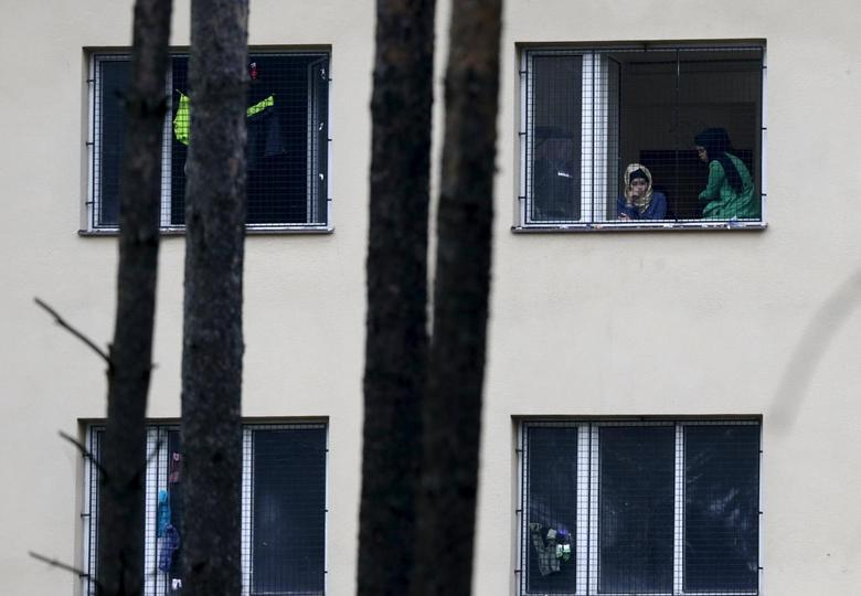 Migrants look out of a window in the Facility For Detention Of Foreigners in Bela-Jezova, Czech Republic, October 13, 2015. REUTERS/David W Cerny