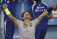 David Ferrer of Spain reacts after winning against Lukas Rosol of Czech Republic during their men's singles match at the China Open tennis tournament in Beijing, China, October 7, 2015.    REUTERS/Kim Kyung-Hoon