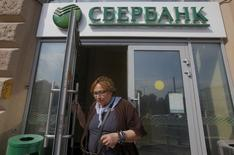 A woman leaves a branch of Sberbank in Moscow, August 26, 2015. REUTERS/Maxim Shemetov