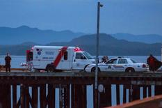 Rescue personnel mounting a search for victims of a capsized whale watching boat park on a wharf in Tofino, British Columbia October 25, 2015. REUTERS/Adam Chilton