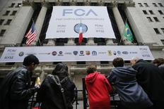 People wait for the arrival of Sergio Marchionne, chief executive officer of Fiat Chrysler Automobiles (FCA) at the New York Stock Exchange October 13, 2014. REUTERS/Eduardo Munoz