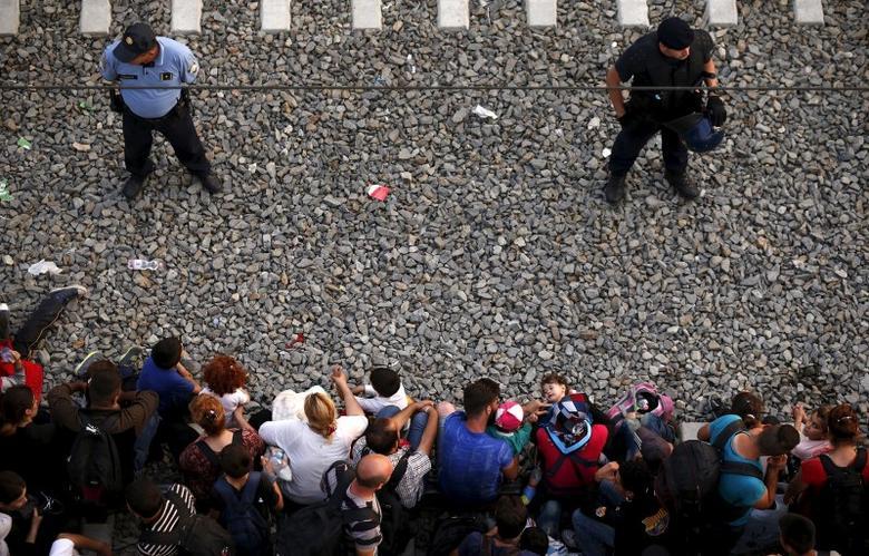Migrants wait to board a train at the train station in Tovarnik, Croatia September 19, 2015. REUTERS/Stoyan Nenov