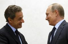 Russian President Vladimir Putin (R) greets Nicolas Sarkozy, former French president and head of the conservative Les Republicains political party, during a meeting at the Novo-Ogaryovo state residence outside Moscow, Russia, October 29, 2015. REUTERS/Sergei Chirikov/Pool