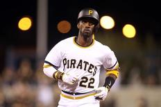 Aug 23, 2015; Pittsburgh, PA, USA; Pittsburgh Pirates center fielder Andrew McCutchen (22) rounds the bases after hitting a solo home run against the San Francisco Giants during the sixth inning at PNC Park. Mandatory Credit: Charles LeClaire-USA TODAY Sports