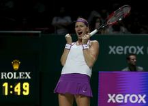 Petra Kvitova of the Czech Republic celebrates defeating Maria Sharapova of Russia in their women's singles semi-finals tennis match of the WTA Finals at the Singapore Indoor Stadium October 31, 2015. REUTERS/Edgar Su