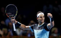 Rafael Nadal of Spain reacts after winning his semi-final match against France's Richard Gasquet at the Swiss Indoors ATP men's tennis tournament in Basel, Switzerland October 31, 2015.   REUTERS/Arnd Wiegmann