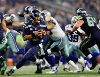 Nov 1, 2015; Arlington, TX, USA; Seattle Seahawks quarterback Russell Wilson (3) throws during the game against the Dallas Cowboys at AT&T Stadium. Mandatory Credit: Kevin Jairaj-USA TODAY Sports