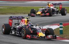 Red Bull's Daniil Kvyat (L) and Daniel Ricciardo in action during qualifying. Reuters / Olivia Harris