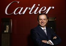 """Stanislas de Quercize, chief executive of Cartier, poses at the """"Salon International de la Haute Horlogerie"""" (SIHH) exhibition in Geneva January 20, 2014. REUTERS/Denis Balibouse"""