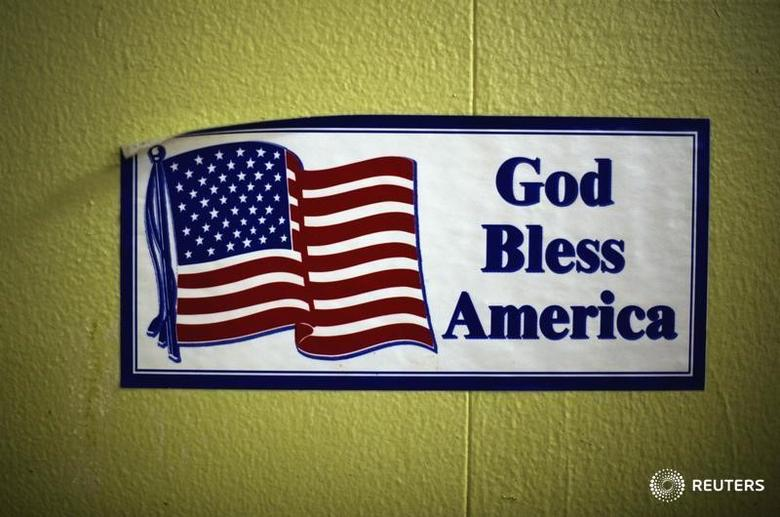 A decal reading ''God Bless America'' is seen on the wall of the soup kitchen in the basement of the St. Leo Catholic Church in Detroit December 17, 2011.   REUTERS/Mark Blinch