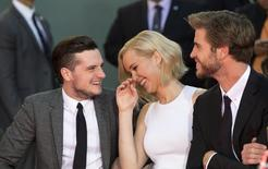 "Actors Josh Hutcherson (L), Jennifer Lawrence and Liam Hemsworth from the upcoming movie ""The Hunger Games: Mockingjay - Part 2"" attend their hand and footprints in cement ceremony in the forecourt of the TCL Chinese theatre in Hollywood, California October 31, 2015.  REUTERS/Mario Anzuoni"