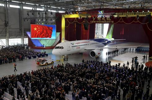 China unveils passenger jet