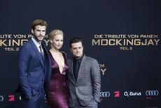 "Cast members Liam Hemsworth (L), Jennifer Lawrence and Josh Hutcherson pose as they arrive for the world premiere of ""The Hunger Games: Mockingjay - Part 2"" in Berlin, Germany, November 4, 2015. REUTERS/Fabrizio Bensch"