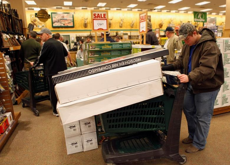 A customer stops to check the advertisement of sale items inside a Cabela's store on the shopping day dubbed ''Black Friday'' in Forth Worth, Texas November 27, 2009. REUTERS/Jessica Rinaldi