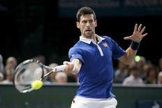 World number one Novak Djokovic of Serbia returns to Britain's Andy Murray during their men's singles final tennis match at the Paris Masters tennis tournament November 8, 2015. REUTERS/Charles Platiau