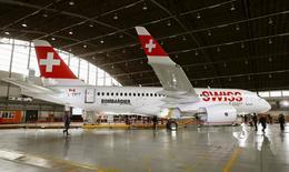 A new Bombardier CS100 passenger jet of Swiss airline stands in a hangar during a media presentation at Zurich airport near the town of Kloten June 18, 2015. REUTERS/Arnd Wiegmann