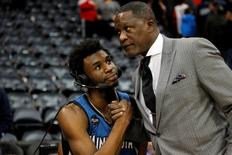 Nov 9, 2015; Atlanta, GA, USA; Atlanta Hawks former forward Dominique Wilkins (right) congratulates Minnesota Timberwolves guard Andrew Wiggins (22) after a game at Philips Arena. The Timberwolves defeated the Hawks 117-107. Mandatory Credit: Brett Davis-USA TODAY Sports