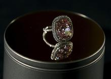 A cushion-shaped 16.08 carat vivid pink diamond is pictured at Christie's auction house in Geneva, Switzerland in this October 30, 2015 file photo.  REUTERS/Denis Balibouse/Files