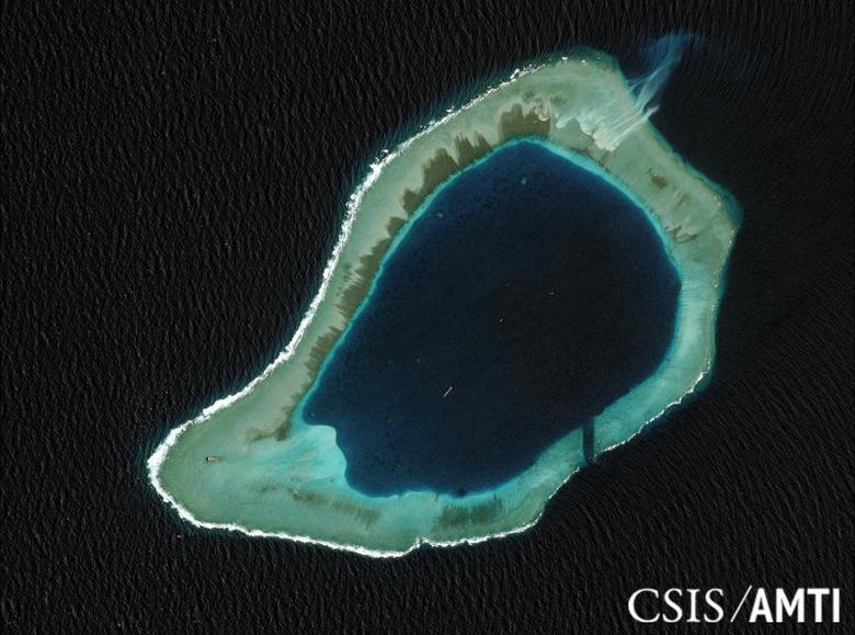 Subi reef, located in the disputed Spratly Islands in the South China Sea, is shown in this handout Center for Strategic and International Studies (CSIS) Asia Maritime Transparency Initiative satellite image taken August 8, 2012, and released to Reuters October 27, 2015. REUTERS/CSIS Asia Maritime Transparency Initiative/DigitalGlobe/Handout via Reuters