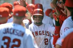 September 6, 2015; Anaheim, CA, USA; Los Angeles Angels shortstop Erick Aybar (2) celebrates after scoring a run in the second inning against the Texas Rangers at Angel Stadium of Anaheim. Mandatory Credit: Gary A. Vasquez-USA TODAY Sports