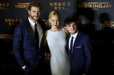"Cast members Liam Hemsworth, Jennifer Lawrence and Josh Hutcherson (L-R) pose at a red carpet event for the China premiere of ""The Hunger Games: Mockingjay - Part 2"" in Beijing, China, November 12, 2015. REUTERS/Kim Kyung-Hoon"