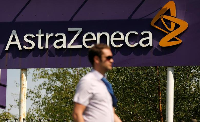 A man walks past a sign at an AstraZeneca site in Macclesfield, central England May 19, 2014. REUTERS/Phil Noble