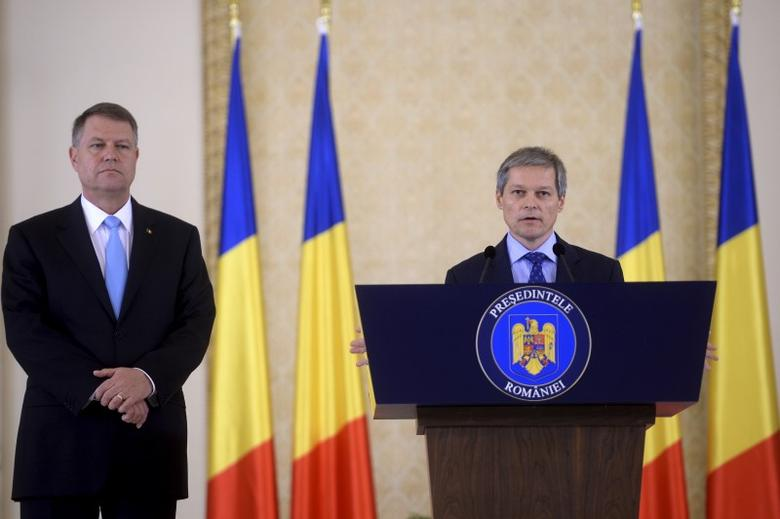 Former European Agriculture Commissioner Dacian Ciolos speaks after being appointed as Romania's prime minister by Romania's centrist President Klaus Iohannis (L) in Bucharest, Romania November 10, 2015. REUTERS/Inquam Photos/Octav Ganea