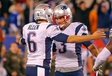 Nov 15, 2015; East Rutherford, NJ, USA;  New England Patriots punter and holder Ryan Allen (6) congratulates kicker Stephen Gostkowski (3) on the game-winning field goal against the New York Giants with 1 second remaining at MetLife Stadium.  Mandatory Credit: Jim O'Connor-USA TODAY Sports