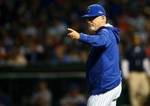 October 20, 2015; Chicago, IL, USA; Chicago Cubs manager Joe Maddon (70) motions to the bullpen in the second inning against the New York Mets in game four of the NLCS at Wrigley Field. Mandatory Credit: Jerry Lai-USA TODAY Sports