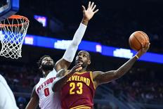 Nov 17, 2015; Auburn Hills, MI, USA; Detroit Pistons center Andre Drummond (0) guards Cleveland Cavaliers forward LeBron James (23) during the first quarter at The Palace of Auburn Hills. Mandatory Credit: Tim Fuller-USA TODAY Sports