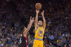November 17, 2015; Oakland, CA, USA; Golden State Warriors guard Stephen Curry (30) shoots the basketball against Toronto Raptors guard Cory Joseph (6) during the fourth quarter at Oracle Arena. The Warriors defeated the Raptors 115-110. Mandatory Credit: Kyle Terada-USA TODAY Sports