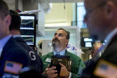 Traders work on the floor of the New York Stock Exchange November 4, 2015. REUTERS/Brendan McDermid