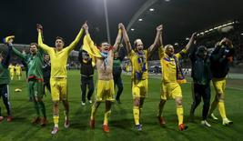 Ukraine's players celebrate after winning against Slovenia at the Stadion Ljudski, Maribor, Slovenia in this November 17, 2015 file photo.  REUTERS/Srdjan Zivulovic/Files