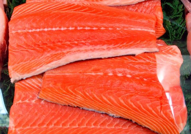 Slabs of salmon are displayed at a market. REUTERS/Lucy Nicholson