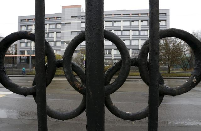 A view through a fence, decorated with the Olympic rings, shows the head office of the Russian Federal Research Centre of Physical Culture and Sports (VNIIFK), on the territory of which a laboratory accredited by the World Anti-Doping Agency (WADA) is located, in Moscow, Russia, November 11, 2015. REUTERS/Sergei Karpukhin/Files