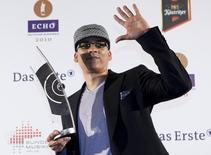 German singer Xavier Naidoo poses with his trophy at the Echo Music Awards ceremony in Berlin March 4, 2010. REUTERS/Thomas Peter/Files