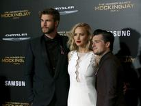 """Cast members Liam Hemsworth (L), Jennifer Lawrence and Josh Hutcherson pose at the premiere of """"The Hunger Games: Mockingjay - Part 2"""" in Los Angeles, California November 16, 2015. The movie opens in the U.S. on November 20.  REUTERS/Mario Anzuoni"""