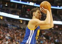 Golden State Warriors guard Klay Thompson (11) shoots the ball during the second half against the Denver Nuggets at Pepsi Center. The Warriors won 118-105. Mandatory Credit: Chris Humphreys-USA TODAY Sports