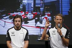 McLaren Formula One drivers Fernando Alonso (L) of Spain and Jenson Button of Britain attend a fan meeting at the Honda Motor Co's headquarters in Tokyo, Japan, September 23, 2015, ahead of Sunday's Japanese F1 Grand Prix.     REUTERS/Toru Hanai
