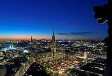 A general view of the Christmas market in front of the historical town hall in Hamburg, November 25, 2013. REUTERS/Fabian Bimmer